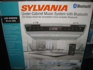 Sylvania Under Kitchen Cabinet Counter Bluetooth FM Radio / CD Player / Clock. Wireless Remote. AC Power. Clear Audio