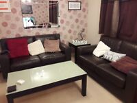 2 brown leather sofas £200