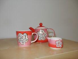 Tea for one, tea pot, cup, milk jug set