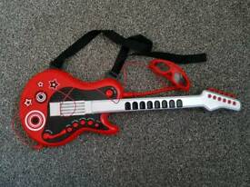 ELC guitar with mic and sunglasses