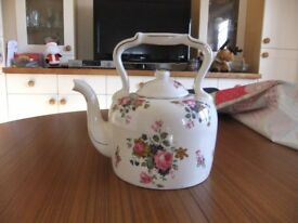 PORCELAIN KETTLE VERY PRETTY WITH A FLOWER PATTERN ON IT & IS IN GOOD CONDITION £10