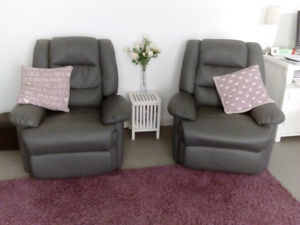 2 X Grey Bonded Leather Manual Reclining Chairs Only 1 Year Old And In Very Good Condition