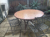 Moroccan mosaic garden table with four metal chairs