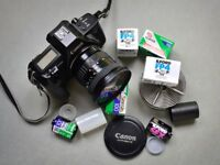 Canon EOS 600 RT Film Camera with zoom lens, rolls of 35mm film and film processing tank