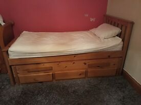 Solid pine furniture. Wardrobe, large storage unit and single bed with bed underneath with 3 drawers