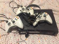 Xbox 360, 3 pads, 2 guitars, 42 games and headset