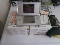 NINTENDO DS LITE SILVER. IMMACULATE CONDITION. WITH GAMES BUNDLE