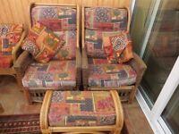 Wicker furniture: 2 x armchairs, 1 x footstool, 2 cushions.