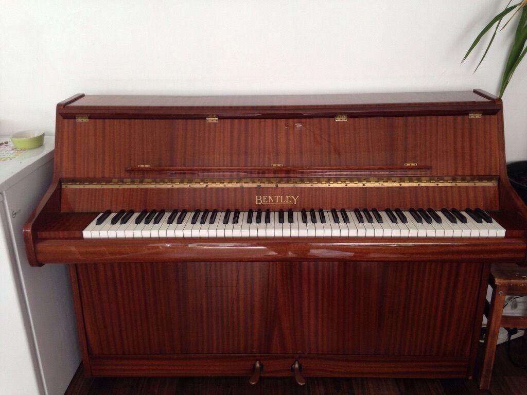 Beautiful Bentley Gloss Mahogany Compact Piano 7 Octaves