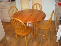 Solid pine drop leaf table and 4 chairs