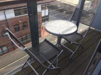 Outside glass table and 2 chairs balcony garden patio