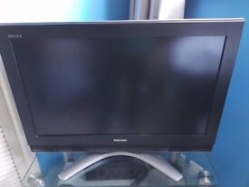 32 inch Toshiba HDTV + Panasonic DVD Video Recorder + Glass TV stand