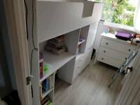 Child's white cabin bed with wardrobe