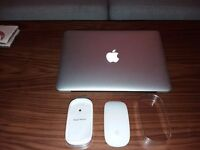 Macbook Pro. Immaculate condition as new with wireless multi touch magic mouse.