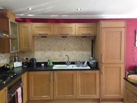 Oak kitchen units and appliances