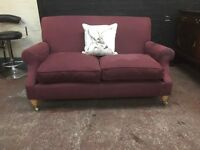 Traditional hand made feather filled roll back two seater sofa