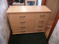 two matching 8 drawer chest of drawers