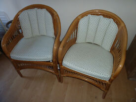 A pair of Cane,Cushioned Chairs Ideal for Conservatory or Summerhouse