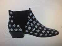 Black boots with silver stars, size 4