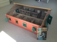 Toy Stable block with higher roof to access inside.