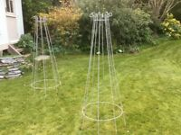 A pair of garden obelisks