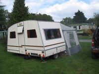 Rapido French folding caravan. 12ft by 6ft 6in when erected, 5ft wide when folded. Easy to tow.