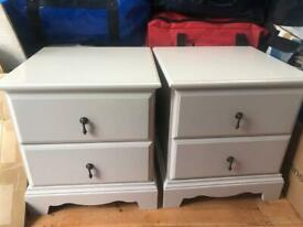 Two grey bedside tables