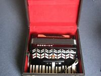 Honica Parrot 72 button accordion, in fair condition,m with case.