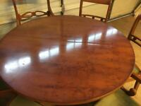 Extending round Dining Table and 8 chairs