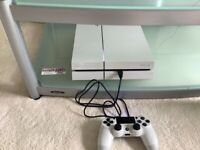 PS4 (hardly Used) with games and brand new 2 controller