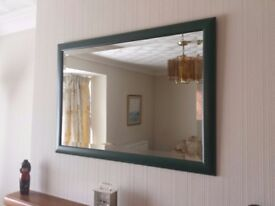 Large wall mirror in wooden frame