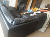 Black L-shaped leather sofa