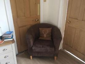 Chocolate suede tub chair