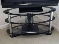 Glass 3 tier tv stand in an excellent condition.