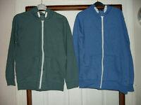 Two boys zip through hooded sweatshirts