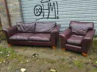 Nice cherry brown leather sofa suite.large 3 seat sofa and armchair .can deliver