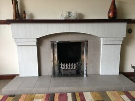 Good condition fireplace for sale. Mix of light and dark grey tiles with mantle place and hearth