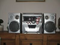 Tevion 3 cd changer hi fi with radio , cassette, and speakers