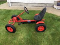 Red Mammoet go-kart with adjustable seat