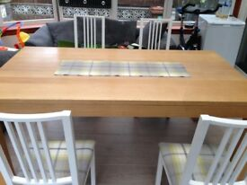 Dining table and 4 chairsfrom sterling , great condition