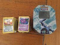 Over 200 Pokemon Cards in tin