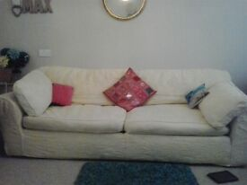 Biscuit coloured 3 seater sofa with removable covers