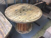 A WAGON WHEEL ROUND PINE GARDEN TABLE