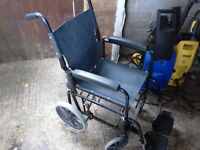 Wheelchair with swivel wheels foot rest and arm rests folds up and fully collapsable vgc