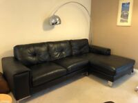 Black leather corner sofa and chair with foot stool