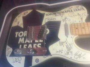 Signed, Framed Toronto Maple Leafs Fender Guitar (#30061) We sell used guitars and musical instruments. We carry Yamaha!