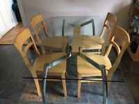 Glass dining table and 4 wooden chairs
