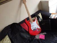 Electric guitar starter kit including amp