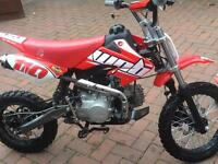 110cc pitbike and helmet an goggles