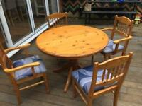 Large dining room table with 4 chairs. Extends to fit more chairs around. Good used condition